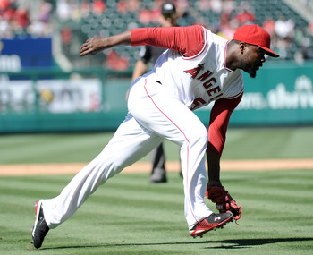 ANAHEIM, CA - SEPTEMBER 12:  Fernando Rodney #56 of the Los Angeles Angels of Anaheim fields a groundball against the Seattle Mariners during the ninth inning at Angel Stadium on September 12, 2010 in Anaheim, California.  Angels won 3-0.  (Photo by Harry