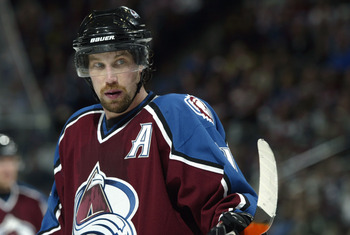 DENVER - MARCH 23:  Peter Forsberg #21 of the Colorado Avalanche waits for the puck to drop on a face-off against the Chicago Blackhawks March 23, 2004 at the Pepsi Center in Denver, Colorado.  The  teams tied 2-2.   (Photo by Brian Bahr/Getty Images)