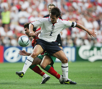 LISBON, PORTUGAL - JUNE 24:  Gary Neville of England stops Deco of Portugal during the UEFA Euro 2004 Quarter Final match between Portugal and England at the Luz Stadium on June 24, 2004 in Lisbon, Portugal. (Photo by Ross Kinnaird/Getty Images)