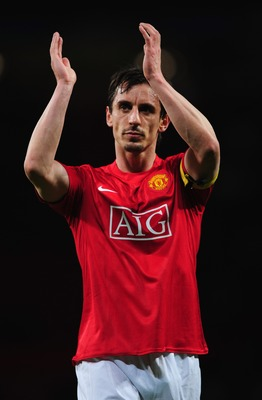 MANCHESTER, UNITED KINGDOM - APRIL 09:  Gary Neville of Manchester United applauds the crowd following the UEFA Champions League Quarter Final 2nd leg match between Manchester United and AS Roma at Old Trafford on April 9, 2008 in Manchester, England.  (P