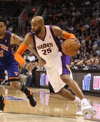 PHOENIX, AZ - JANUARY 07:  Vince Carter #25 of the Phoenix Suns drives the ball against the New York Knicks during the NBA game at US Airways Center on January 7, 2011 in Phoenix, Arizona.  NOTE TO USER: User expressly acknowledges and agrees that, by dow