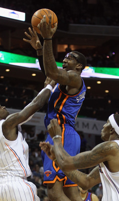 CHARLOTTE, NC - NOVEMBER 24:  Amare Stoudemire #1 of the New York Knicks drives to the basket over Stephen Jackson #1 of the Charlotte Bobcats at Time Warner Cable Arena on November 24, 2010 in Charlotte, North Carolina.  NOTE TO USER: User expressly ackn