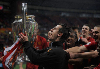 MOSCOW - MAY 21: Gary Neville of Manchester United lifts the trophy during the UEFA Champions League Final match between Manchester United and Chelsea at the Luzhniki Stadium on May 21, 2008 in Moscow, Russia.  (Photo by Shaun Botterill/Getty Images)