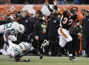 CINCINNATI - JANUARY 9:  Running back Cedric Benson #32 of the Cincinnati Bengals runs with the ball against the New York Jets during the 2010 AFC wild-card playoff game at Paul Brown Stadium on January 9, 2010 in Cincinnati, Ohio. (Photo by Andy Lyons/Ge