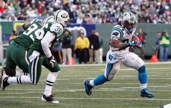 EAST RUTHERFORD, NJ - NOVEMBER 29:  DeAngelo Williams #34 of the Carolina Panthers runs the ball against the New York Jetson November 29, 2009 at Giants Stadium in East Rutherford, New Jersey. The Jets defeated the Panthers 17-6.  (Photo by Jim McIsaac/Ge