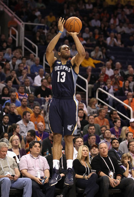 PHOENIX - DECEMBER 08:  Xavier Henry #13 of the Memphis Grizzlies puts up a three point shot against the Phoenix Suns during the NBA game at US Airways Center on December 8, 2010 in Phoenix, Arizona. The Grizzlies defeated the Suns 104-98 in overtime.  NO