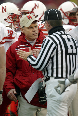LAWRENCE, KS - NOVEMBER 8:  Head coach Frank Solich of the Nebraska Cornhuskers questions head linesman Dave Alexander after the Cornhuskers lost possession on a fumble that rolled into the endzone for a touchback for the Kansas Jay Hawks in the second qu