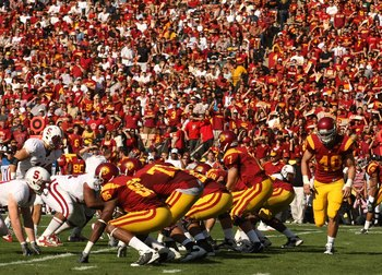 LOS ANGELES, CA - NOVEMBER 14:  The USC Trojans offense sets on the line of scrimmage against the Stanford Cardinal on November 14, 2009 at the Los Angeles Coliseum in Los Angeles, California.  Stanford won 55-21.  (Photo by Stephen Dunn/Getty Images)