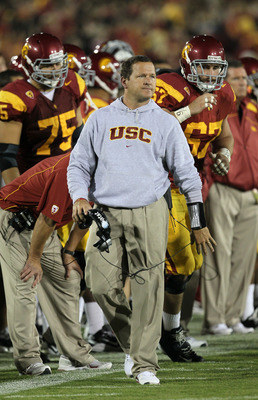 LOS ANGELES, CA - SEPTEMBER 11:  Linebackers coach Joe Barry of the USC Trojans on the field during the game with the Virginia Cavaliers at Los Angeles Memorial Coliseum on September 11, 2010 in Los Angeles, California.  (Photo by Stephen Dunn/Getty Image