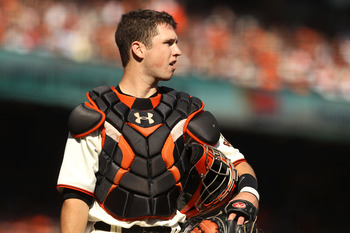 SAN FRANCISCO - OCTOBER 19:  Buster Posey #28 of the San Francisco Giants stands on the field during Game Three of the NLCS against the Philadelphia Phillies during the 2010 MLB Playoffs at AT&T Park on October 19, 2010 in San Francisco, California.  (Pho