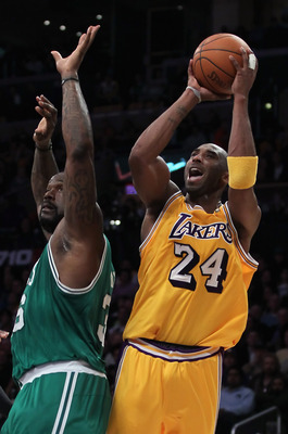 LOS ANGELES, CA - JANUARY 30:  Kobe Bryant #24 of the Los Angeles Lakers is fouled while shooting by Shaquille O'Neal #36 of the Boston Celtics in the first half at Staples Center on January 30, 2011 in Los Angeles, California. The Celtics defeated the La