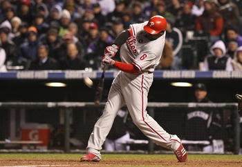 DENVER - OCTOBER 11:  Ryan Howard #6 of the Philadelphia Phillies hits a go ahead RBI sacrifice fly against the Colorado Rockies in the top of the ninth inning to give the Phillies a 6-5 lead in Game Three of the NLDS during the 2009 MLB Playoffs at Coors
