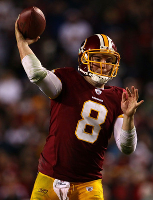 LANDOVER, MD - JANUARY 02:  Quarterback Rex Grossman #8 of the Washington Redskins throws a pass in the fourth quarter of a game against the New York Giants at FedEx Field on January 2, 2011 in Landover, Maryland. The Giants won the game 17-14.  (Photo by