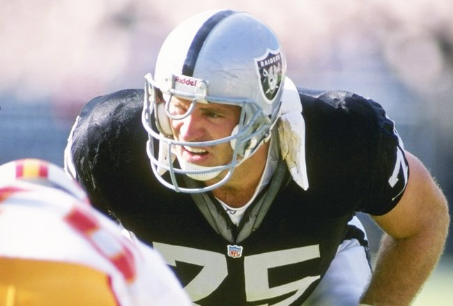 19 Dec 1993:  Defensive lineman Howie Long of the Los Angeles Raiders looks on during a game against the Tampa Bay Buccaneers at the Los Angeles Memorial Coliseum in Los Angeles, California.  The Raiders won the game, 27-20. Mandatory Credit: Markus Boesc