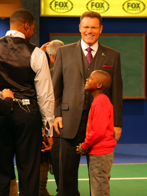 LOS ANGELES, CA - DECEMBER 12:  FOX NFL Sunday analysts Michael Strahan and Howie Long share a laugh with St. Jude Children's Research Hospital patient Markell during a break on the set of FOX NFL Sunday on December 12, 2010 in Los Angeles, United States.