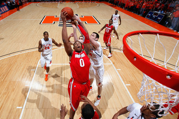 CHAMPAIGN, IL - JANUARY 22: Jared Sullinger #0 of the Ohio State Buckeyes pulls down one of his game-high 16 rebounds against the Illinois Fighting Illini at Assembly Hall on January 22, 2011 in Champaign, Illinois. Ohio State won 73-68. (Photo by Joe Rob