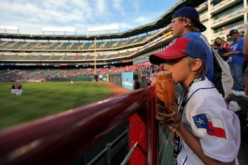 ARLINGTON, TX - NOVEMBER 01:  Fans of the Texas Rangers watch batting practice against the San Francisco Giants in Game Five of the 2010 MLB World Series at Rangers Ballpark in Arlington on November 1, 2010 in Arlington, Texas.  (Photo by Doug Pensinger/G