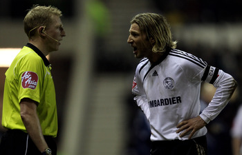 DERBY, ENGLAND - FEBRUARY 16: Robbie Savage of Derby makes his point to the assistant referee during the Coca Cola Championship match between Derby County and Preston North End at Pride Park on February 16, 2010 in Derby, England.  (Photo by Ross Kinnaird