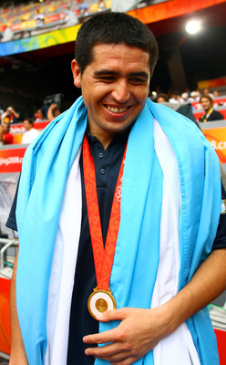 BEIJING - AUGUST 23: Argentinian Juan Roman Riquelme his national flag during the men's Olympic football tournament medal ceremony at the Men's Final between Nigeria and Argentina at the National Stadium on Day 15 of the Beijing 2008 Olympic Games on Augu