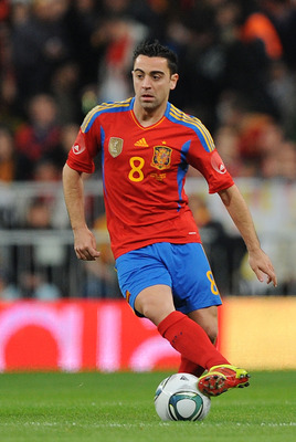 MADRID, SPAIN - FEBRUARY 09:   Xavi Hernandez of Spain in action during the International friendly match between Spain and Colombia at Estadio Santiago Bernabeu on February 9, 2011 in Madrid, Spain.  (Photo by Denis Doyle/Getty Images)