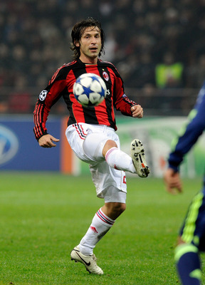 MILAN, ITALY - DECEMBER 08:  Andrea Pirlo of AC Milan during the UEFA Champions League Group G match between AC Milan and AFC Ajax at Stadio Giuseppe Meazza on December 8, 2010 in Milan, Italy.  (Photo by Claudio Villa/Getty Images)