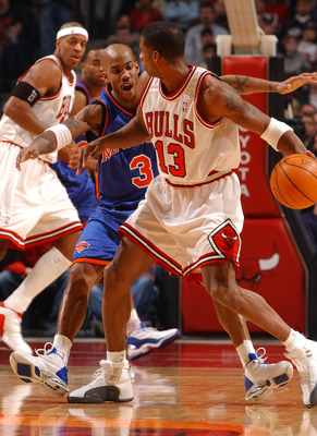 CHICAGO - JANUARY 17: Guard Stephon Marbury #3 of the New York Knicks pressures guard Kendall Gill #13 of the Chicago Bulls during a game on January 17, 2004 at the United Center in Chicago, Illinois. The Knicks defeated the Bulls 101-96. NOTE TO USER: Us