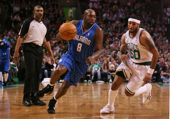 BOSTON - NOVEMBER 20: Anthony Johnson #8 of the Orlando Magic drives the ball up court against Eddie House #50 of the Boston Celtics during the game on November 20, 2009 at the TD Garden in Boston, Massachusetts. NOTE TO USER: User expressly acknowledges