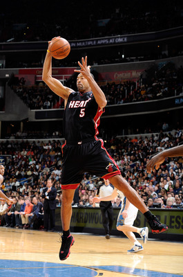 WASHINGTON, DC - DECEMBER 18:  Juwan Howard #5 of the Miami Heat grabs a rebound against the Washington Wizards at the Verizon Center on December 18, 2010 in Washington, DC. NOTE TO USER: User expressly acknowledges and agrees that, by downloading and or