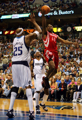 DALLAS - APRIL 23:  Guard Mike James #13 of the Houston Rockets drives the hoop against Erick Dampier #25 of the Dallas Mavericks in Game one of the Western Conference Quarterfinals during the 2005 NBA Playoffs on April 23, 2005 at the American Airlines C