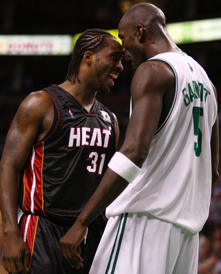 BOSTON - NOVEMBER 16:Kevin Garnett #5 of the Boston Celtics celebrates after he is fouled by Shaquille O'Neal as Ricky Davis #31 of the Miami Heat joins in on the fun on November 16, 2007 at the TD Banknorth Garden in Boston, Massachusetts. NOTE TO USER: