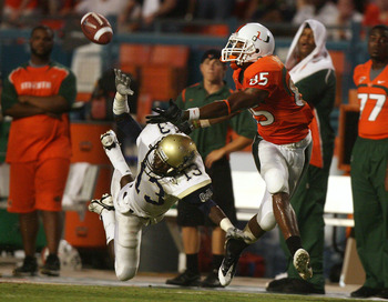 MIAMI - AUGUST 28:  Defensive back Jacques Bazile #13 of the Charleston Southern Buccaneers dives to try and knock down a pass intended for wide receiver Leonard Hankerson #85 of the Miami Hurricanes at Dolphin Stadium on August 28, 2008 in Miami, Florida