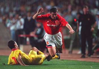 28 SEP 1994:  ROY KEANE OF MANCHESTER UNITED IS BROUGHT DOWN BY TEPEKULE YUSEF OF GALATASARY DURING THE GALATASARY V MANCHESTER UNITED CHAMPIONS LEAGUE MATCH IN ISTANBUL, TURKEY. Mandatory Credit: Graham Chadwick/ALLSPORT