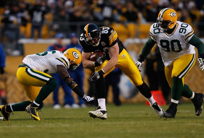 PITTSBURGH - DECEMBER 20: Heath Miller #83 of the Pittsburgh Steelers attemps to run through a tackle by BJ Raji #90 and Nick Collins #36 of the Green Bay Packers during the game on December 20, 2009 at Heinz Field in Pittsburgh, Pennsylvania. (Photo by J
