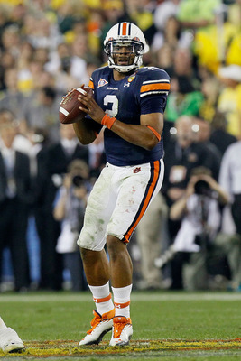 GLENDALE, AZ - JANUARY 10:  Cameron Newton #2 of the Auburn Tigers scrambles against the Oregon Ducks during the Tostitos BCS National Championship Game at University of Phoenix Stadium on January 10, 2011 in Glendale, Arizona.  (Photo by Kevin C. Cox/Get