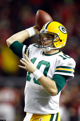 ATLANTA, GA - JANUARY 15:  Matt Flynn #10 of the Green Bay Packers losens up on the sideline against the Atlanta Falcons during their 2011 NFC divisional playoff game at Georgia Dome on January 15, 2011 in Atlanta, Georgia.  (Photo by Chris Graythen/Getty