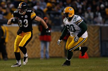 PITTSBURGH - DECEMBER 20: Heath Miller #83 of the Pittsburgh Steelers runs with the ball from BJ Raji #90 of the Green Bay Packers during the game on December 20, 2009 at Heinz Field in Pittsburgh, Pennsylvania. (Photo by Jared Wickerham/Getty Images)