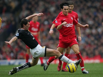 LIVERPOOL, ENGLAND - JANUARY 15:  Roy Keane of Manchester United tackles Luis Garcia of Liverpool during the Barclays Premiership match between Liverpool and Manchester United at Anfield on January 15, 2004 in Manchester, England.  (Photo by Alex Livesey/