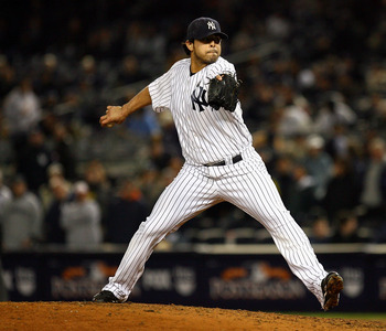 NEW YORK - OCTOBER 19:  Sergio Mitre #45 of the New York Yankees pitches against the Texas Rangers in Game Four of the ALCS during the 2010 MLB Playoffs at Yankee Stadium on October 19, 2010 in the Bronx borough of New York City. The Rangers won 10-3.  (P