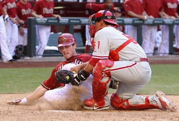 PHOENIX - APRIL 25:  Catcher Carlos Ruiz #51 of the Philadelphia Phillies tags out the sliding Stephen Drew #6 of the Arizona Diamondbacks at home plate during the eighth inning of the Major League Baseball game at Chase Field on April 25, 2010 in Phoenix