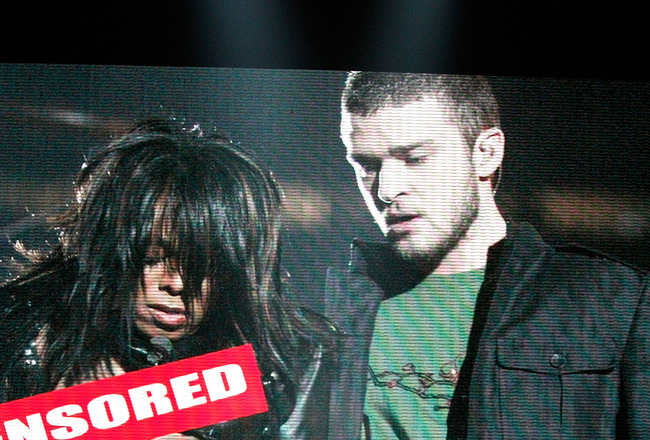 LOS ANGELES, CA - JULY 16:  Host Justin Timberlake stands onstage in front of a video of himself and Janet Jackson from Super Bowl XXXVIII onstage at the 2008 ESPY Awards held at NOKIA Theatre L.A. LIVE on July 16, 2008 in Los Angeles, California.  The 20