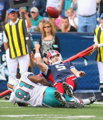 ORCHARD PARK, NY - SEPTEMBER 12: Trent Edwards #5 of the Buffalo Bills is sacked by Cameron Wake #91 of the Miami Dolphins during the NFL season opener at Ralph Wilson Stadium on September 12, 2010 in Orchard Park, New York. The Dolphins won 15-10. (Photo