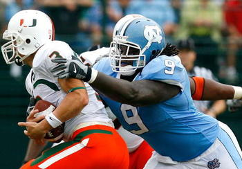 CHAPEL HILL, NC - OCTOBER 06:  Defensive tackle Marvin Austin #9 of the North Carolina Tar Heels sacks quarterback Kyle Wright #3 of the Miami Hurricanes during the first half at Kenan Stadium on October 6, 2007 in Chapel Hill, North Carolina.  (Photo by