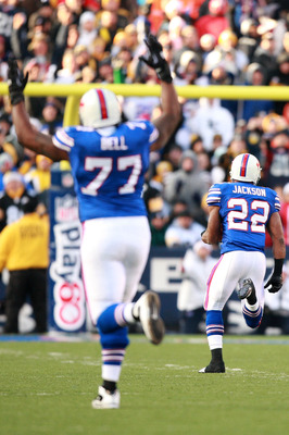 ORCHARD PARK, NY - NOVEMBER 28:  Demetrius Bell #77 reacts while Fred Jackson #22 of the Buffalo Bills rushes for a touchdown during the game against the Pittsburgh Steelers at Ralph Wilson Stadium on November 28, 2010 in Orchard Park, New York.  (Photo b