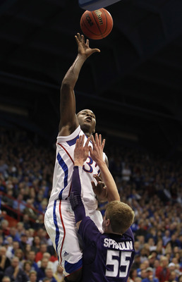 LAWRENCE, KS - JANUARY 29:  Josh Selby #32 of the Kansas Jayhawks shoots over Will Spradling #55 of the Kansas State Wildcats during the game on January 29, 2011 at Allen Fieldhouse in Lawrence, Kansas.  (Photo by Jamie Squire/Getty Images)