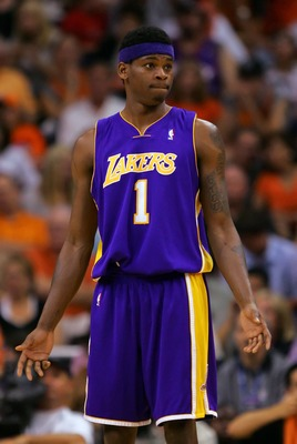 PHOENIX - MAY 02:   Smush Parker #1 of the Los Angeles Lakers reacts in the first half against the Phoenix Suns in Game Five of the Western Conference Quarterfinals during the 2007 NBA Playoffs at US Airways Center on May 2, 2007 in Phoenix, Arizona.  NOT