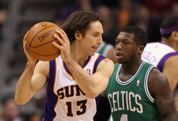 PHOENIX, AZ - JANUARY 28:  Steve Nash #13 of the Phoenix Suns handles the ball during the NBA game against the Boston Celtics at US Airways Center on January 28, 2011 in Phoenix, Arizona. The Suns defeated the Celtics 88-71. NOTE TO USER: User expressly a