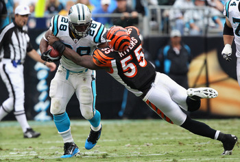 CHARLOTTE, NC - SEPTEMBER 26:  Keith Rivers #55 of the Cincinnati Bengals tackles Jonathan Stewart #28 of the Carolina Panthers during their game at Bank of America Stadium on September 26, 2010 in Charlotte, North Carolina.  (Photo by Streeter Lecka/Gett