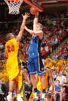 COLLEGE PARK, MD - FEBRUARY 2:  Mason Plumlee #5 of the Duke Blue Devils takes a shot over Jordan WIlliams #20 of the Maryland Terrapins during a college basketball game on February 2, 2011 at the Comcast Arena in College Park, Maryland.  The Blue Devils