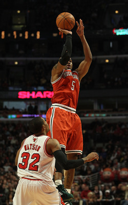 CHICAGO, IL - DECEMBER 28: Corey Maggette #5 of the Milwaukee Bucks puts up a shot over C.J. Watson #32 of the Chicago Bulls at the United Center on December 28, 2010 in Chicago, Illinois. The Bulls defeated the Bucks 90-77. NOTE TO USER: User expressly a