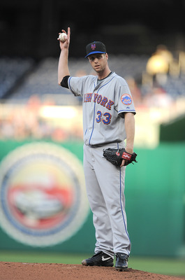 WASHINGTON - MAY 20:  John Maine #33 of the New York Mets motions towards the dugout during the first inning of the game against the Washington Nationals at Nationals Park on May 20, 2010 in Washington, DC.  (Photo by Greg Fiume/Getty Images)